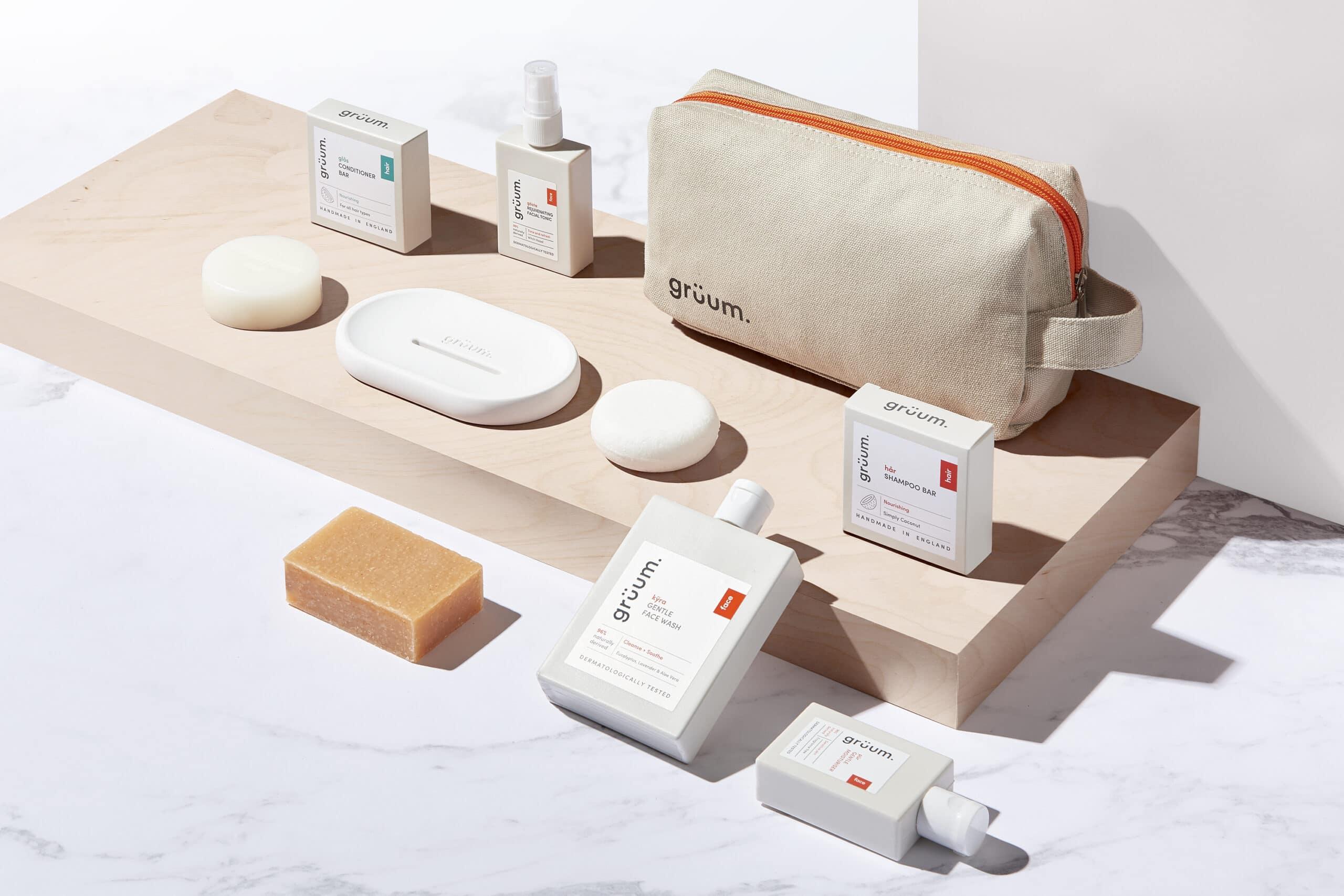 Gruum travel kit gift set product image with washbag, kyra face wash, shampoo bar, conditioner bar, pur moisturiser, body bar, gosta facial tonic and white halla soap dish