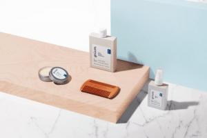 Gruum product image with bard beard shampoo, leif beard oil, tor beard wax and wooden beard comb